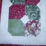 This picture shows the detail on the quilting. Yes, I did it by machine. I'm not nearly as patient as Leanna :)